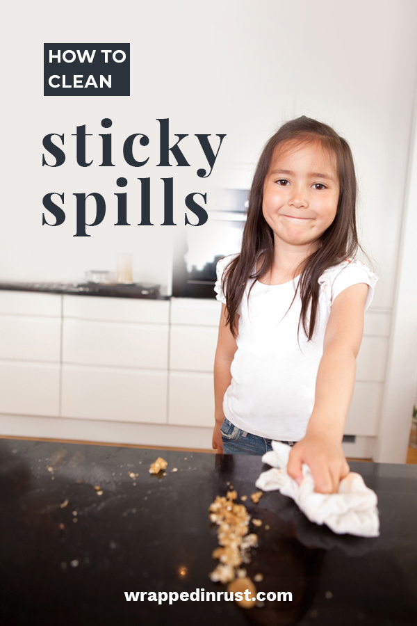 Sticky spills.... every house has them. They can be a pain but if you know the secrets to cleaning them, you won't sweat when your kids spills honey or syrup etc. Keep reading to learn my favorite way to clean sticky spills. It's really easy to deal with this mess. #howtocleanstickyspills